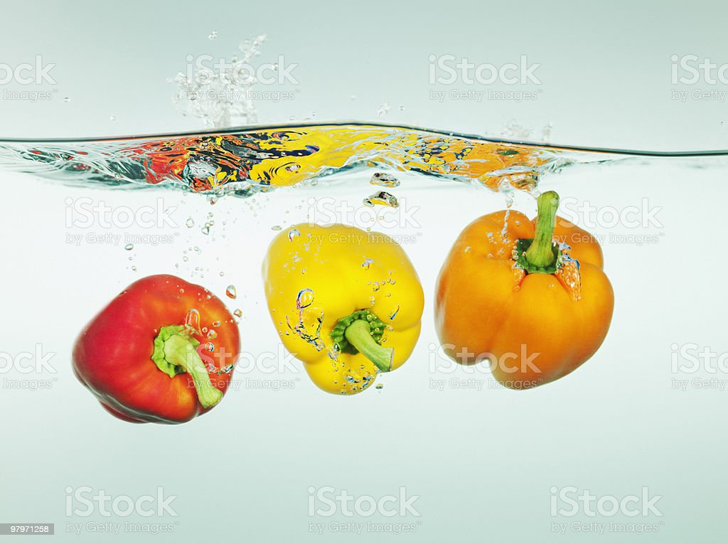Bell peppers splashing in water royalty-free stock photo
