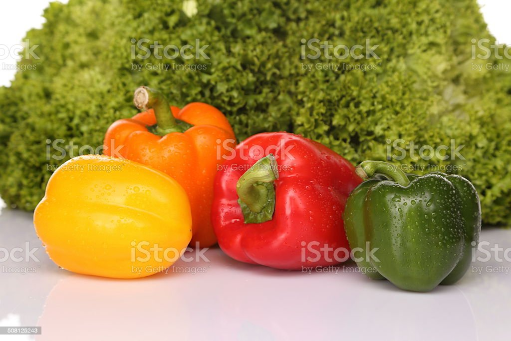 Bell Peppers with salad leaves stock photo