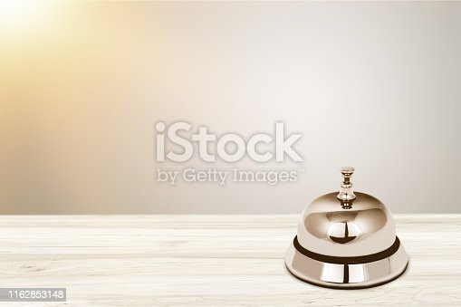 Reception service desk bell on light background