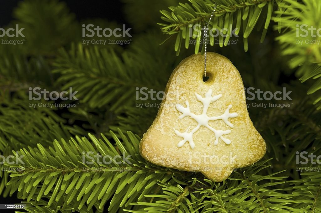 Bell shape short bread cookie in  Christmas tree royalty-free stock photo