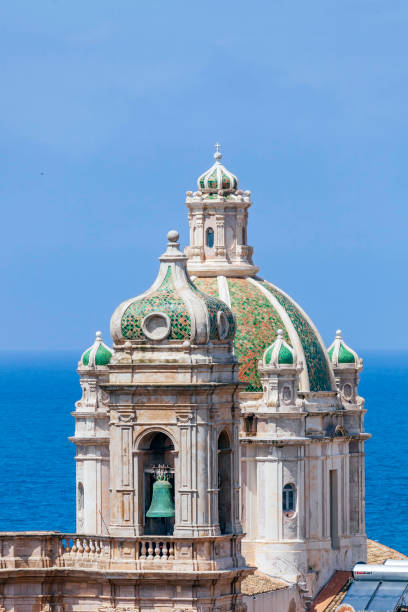 Bell Tower and adjacent Dome above the Cattedrale di S. Lorenzo in Trapini Sicily.