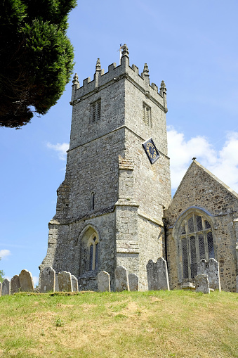 Godshill, Isle of Wight, UK. June 21, 2018. The All Saints church belltower standing on the hill at Godshill on the Isle of Wight , UK.