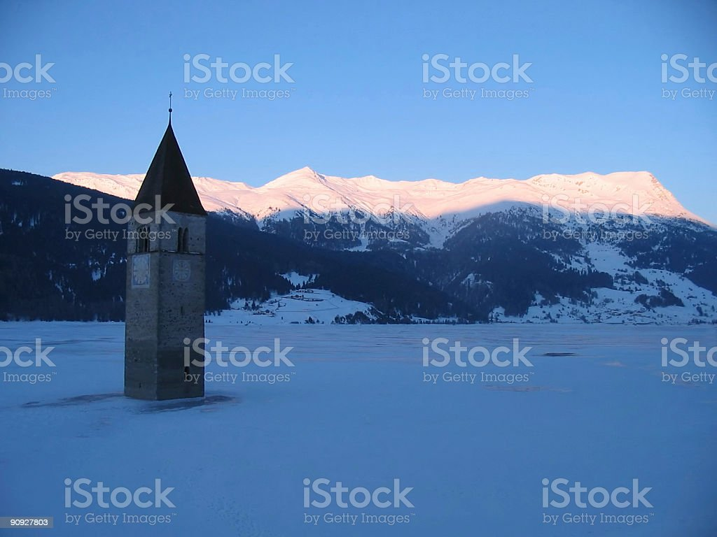 Bell Tower in a Frozen Lake, Italian Alps, Dolomites Nobody royalty-free stock photo