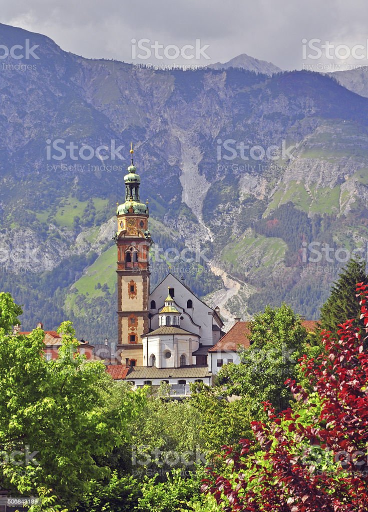 Bell tower in tyrolean Alps stock photo