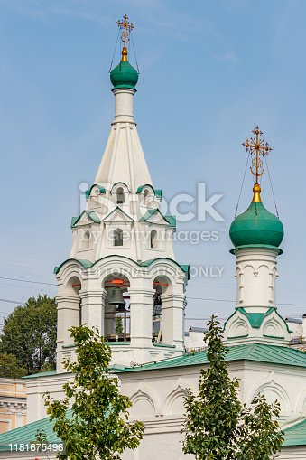 Moscow, Russia - September 13, 2019: Bell tower of Church of Saint Simeon the Stylite on Povarskaya street close-up on a blue sky background at sunny autumn day