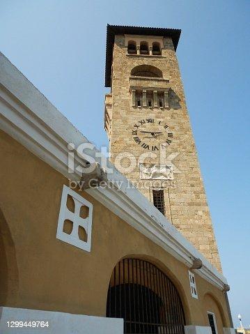 istock Bell tower of Church of the Evangelismos (Annunciation) towards the sky. Mandraki harbor, Rhodes 1299449764