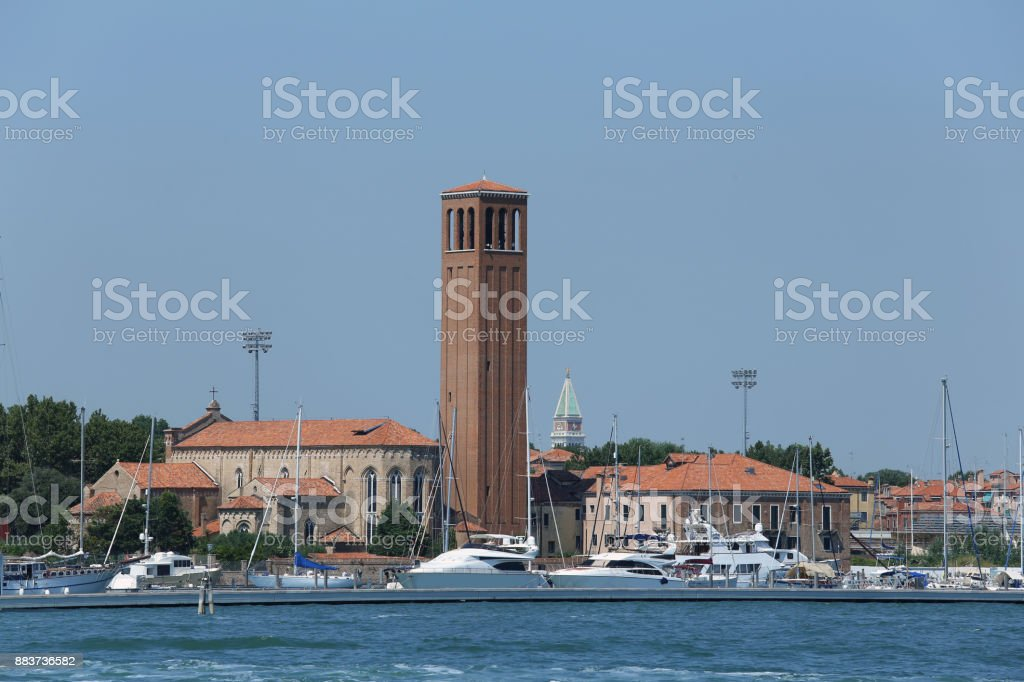 bell tower of Saint  Elena Island in Venice in Italy and th boat stock photo