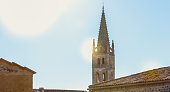 the bell tower of the small French town of Saint Emilion in backligh