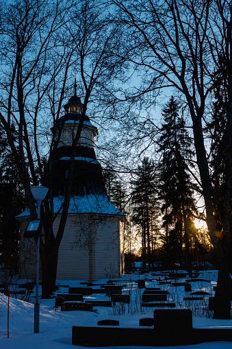 Kouvola, Finland - 10 March 2021: Bell tower of Valkeala church in sunset
