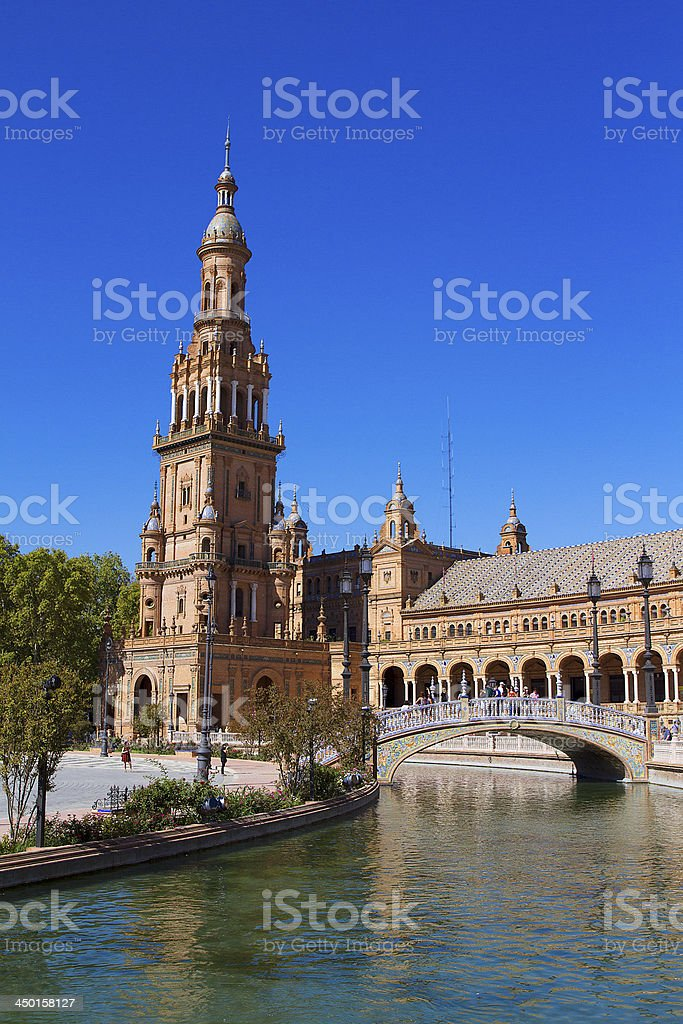 Bell tower, river and palace in Plaza de España, Seville. stock photo