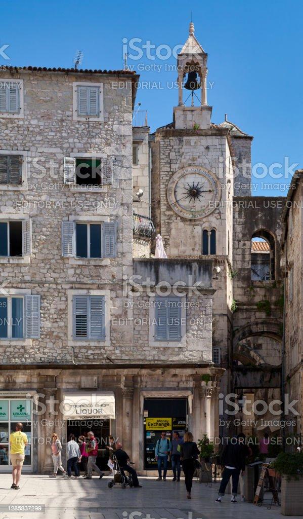Bell tower under the clock in Split Split, Croatia - April 16 2019: The bell tower under the clock (Croatian: Zvonik Ispod ure) next to the Iron gate (Croatian: Željezna vrata). Ancient Stock Photo
