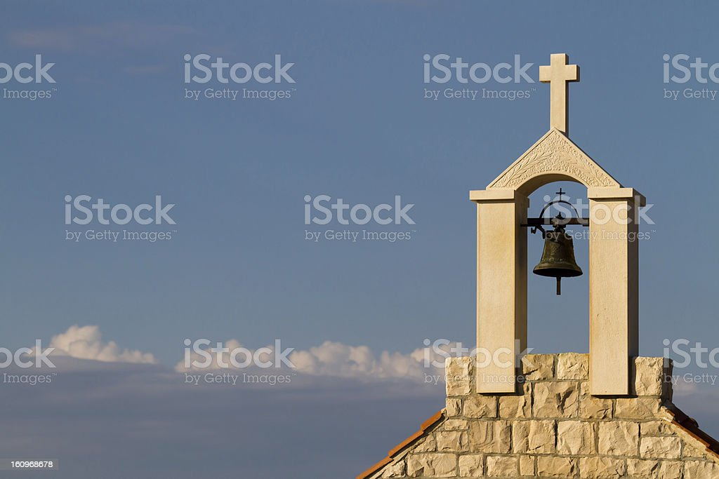 Bell with Christian cross stock photo