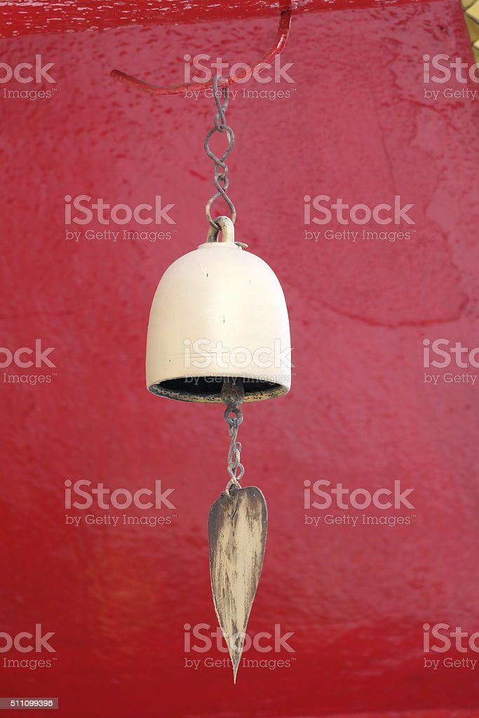 Bell with red wall background stock photo