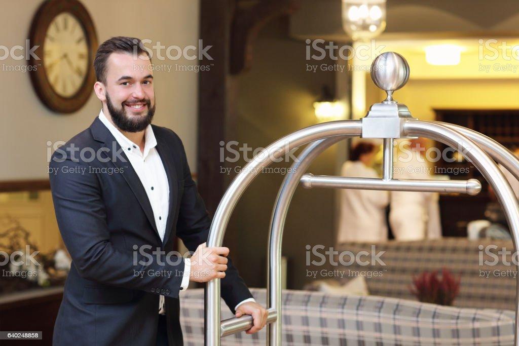 Bellboy in hotel stock photo