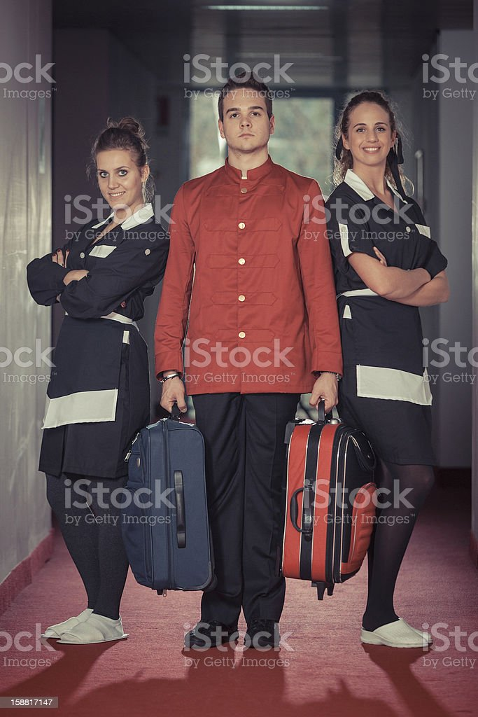 Bellboy with Two Beautiful Chambermaids stock photo