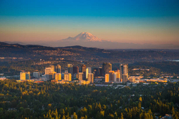 Bellevue Downtown Bellevue, Washington with Mt. Rainier in background as seen from helicopter washington state stock pictures, royalty-free photos & images