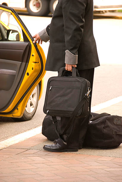 Bellhop and Taxi stock photo