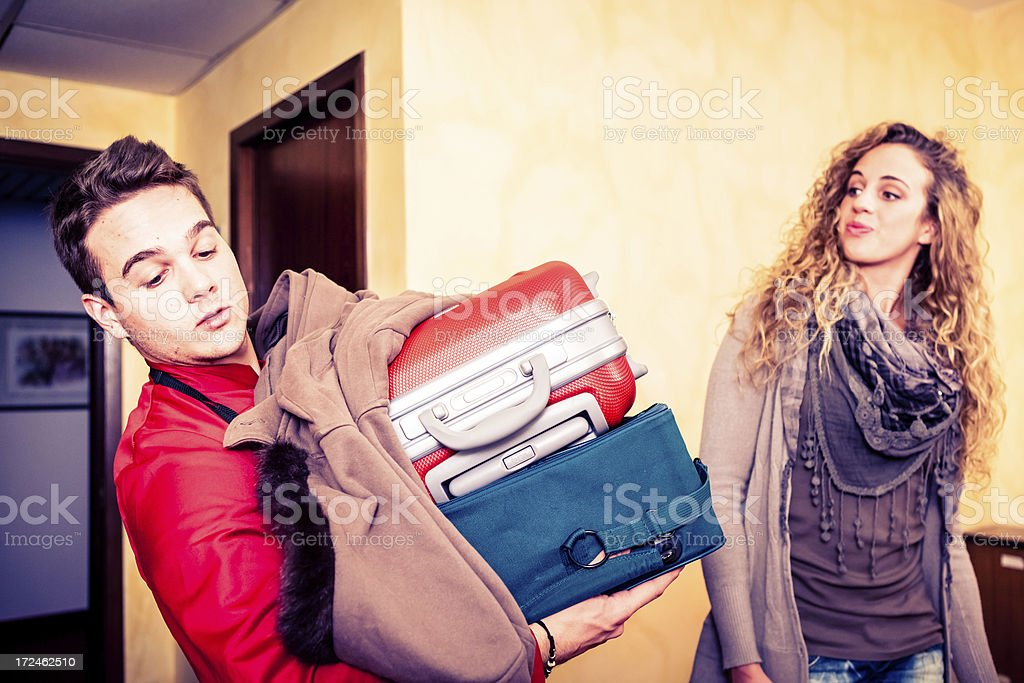 Bellhop Carrying Luggage to Hotel Room royalty-free stock photo