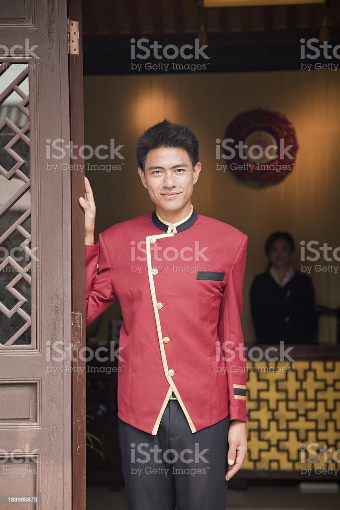 Bellhop in the doorway smiling, portrait stock photo