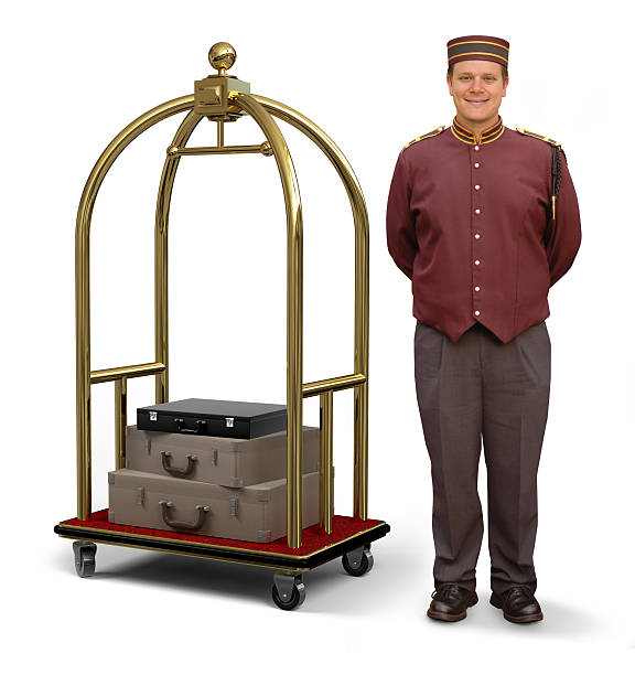 Bellhop with Luggage Cart stock photo