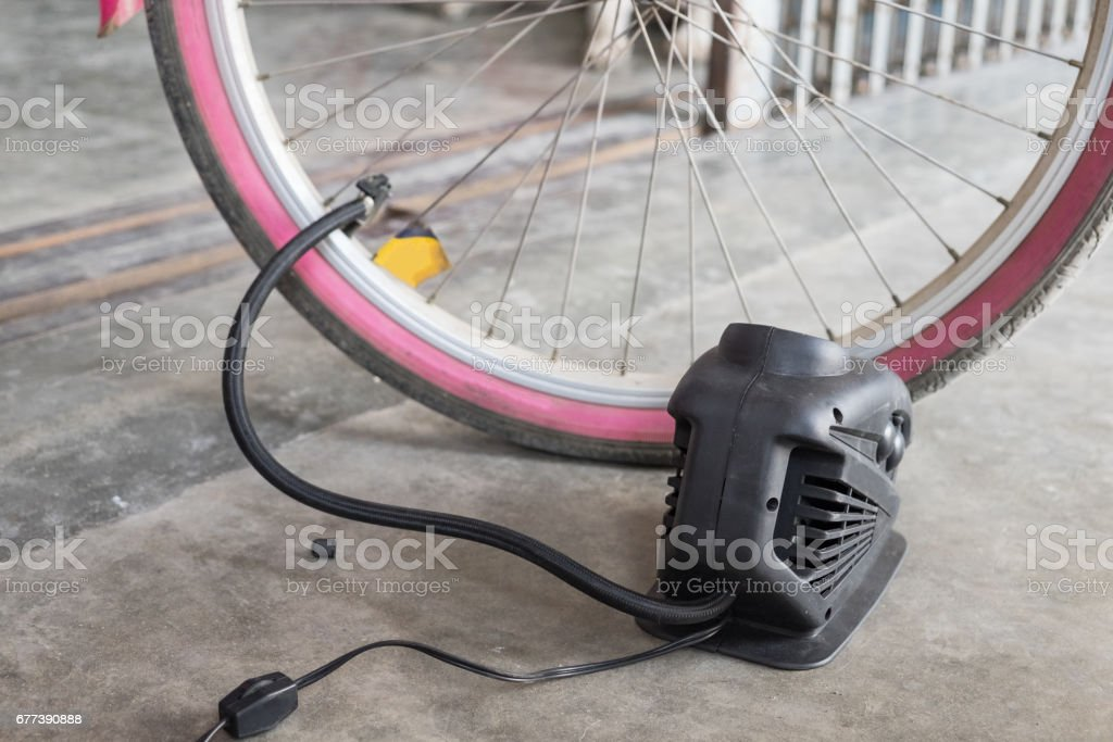 Bellows tire inflate to bicycle stock photo