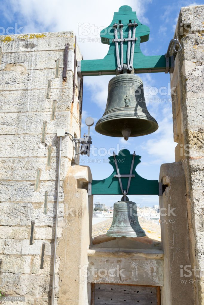 Bells at the top of the Cathedral of Faro stock photo