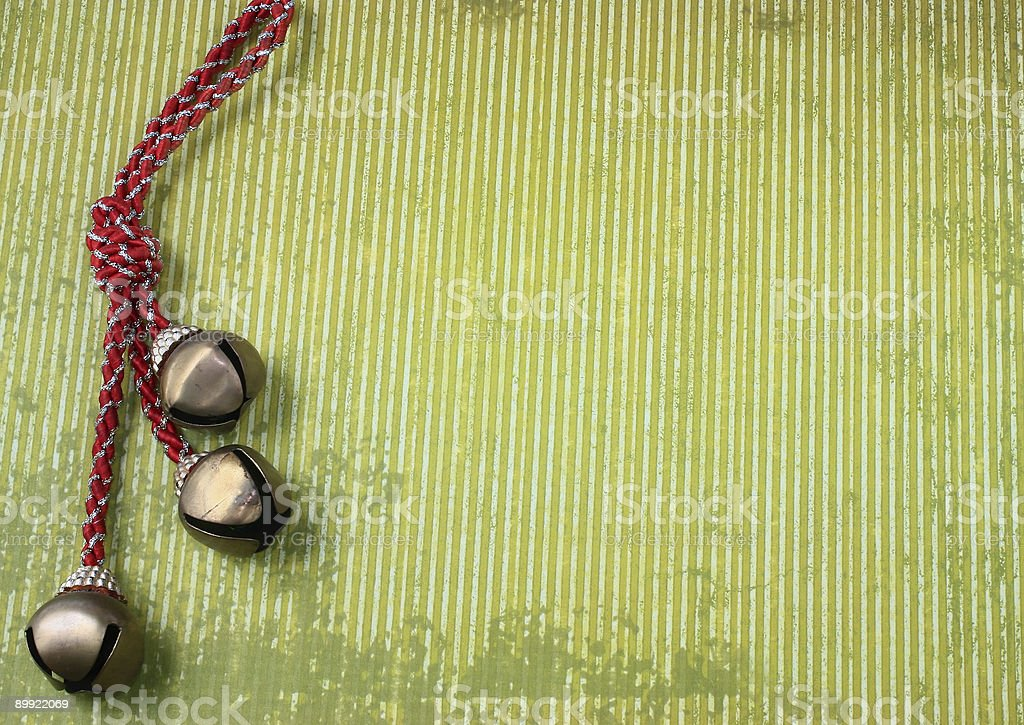 Bells with red tassel on Abstract Green Holiday Background stock photo