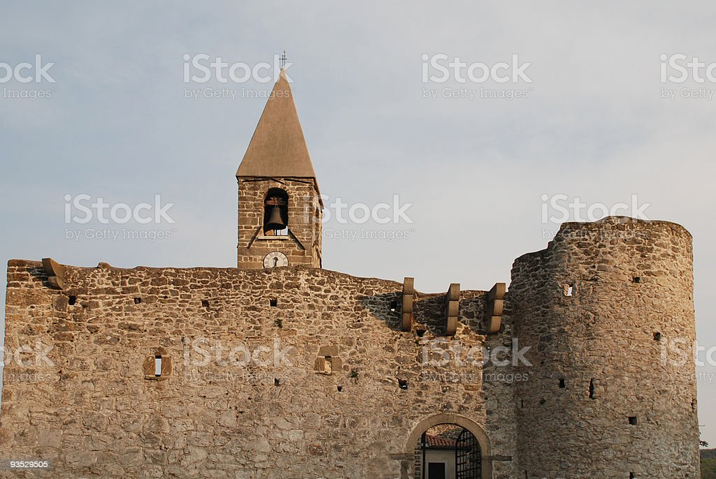 Belltower and Wall of SS Trinity in Hrastovlj stock photo