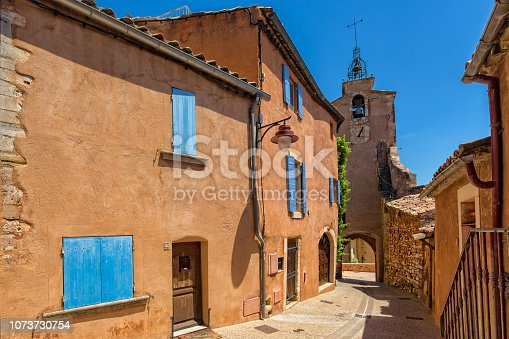 Tower and houses with red ocher color, Roussillon, Provence, Luberon, Vaucluse, France