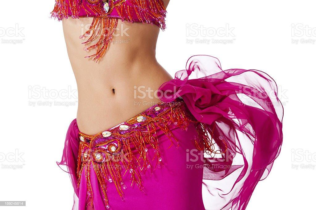 Bauchtänzerin in ein warmes Rosa Kleidung mit dem die Hüfte – Foto