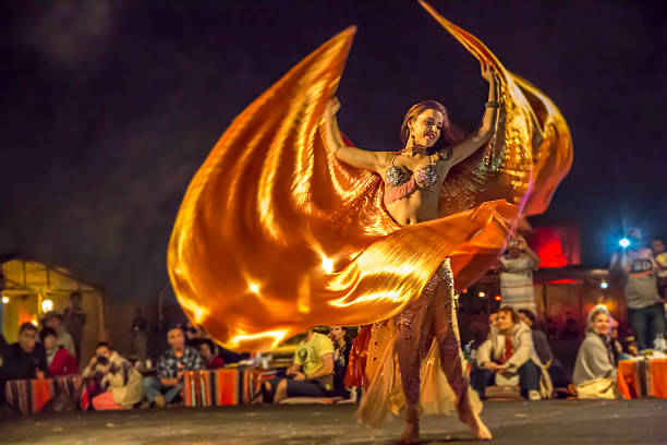 Belly dancer in action with multicolored costume stock photo