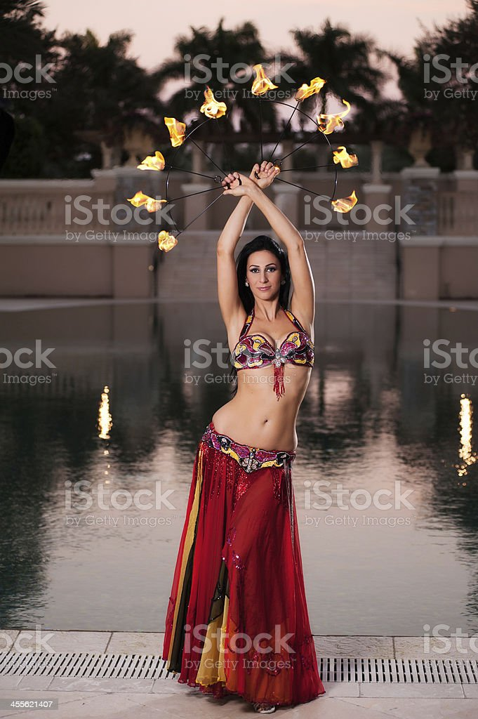 Belly Dancer in Red Costume with Fire Fans royalty-free stock photo