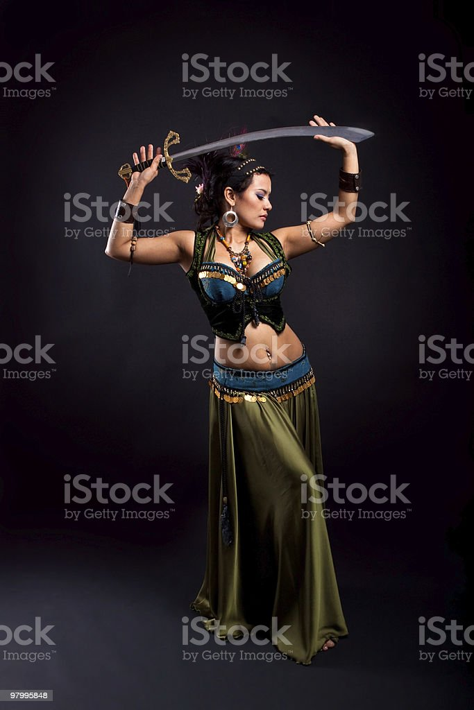 Belly dancer performing sword dance royalty-free stock photo