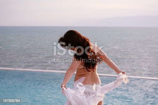 istock Belly dancer, pool and sea 157305764