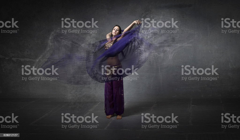 belly dancer with a fade veil explosion stock photo