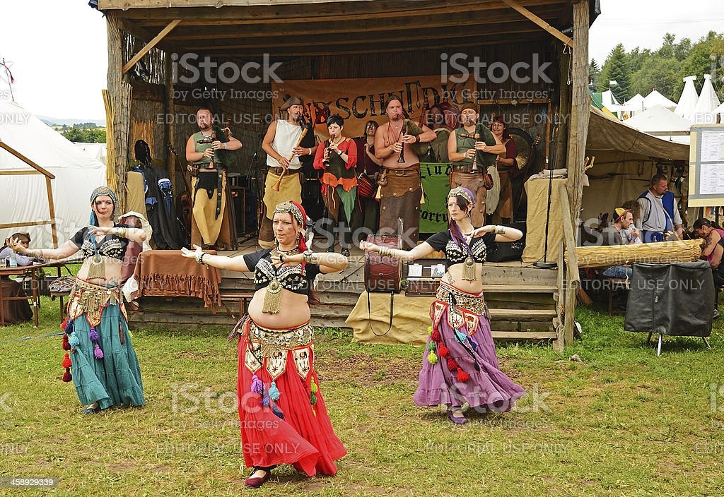Belly dancers and music band at medieval festival royalty-free stock photo