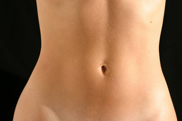 belly navel stock photo