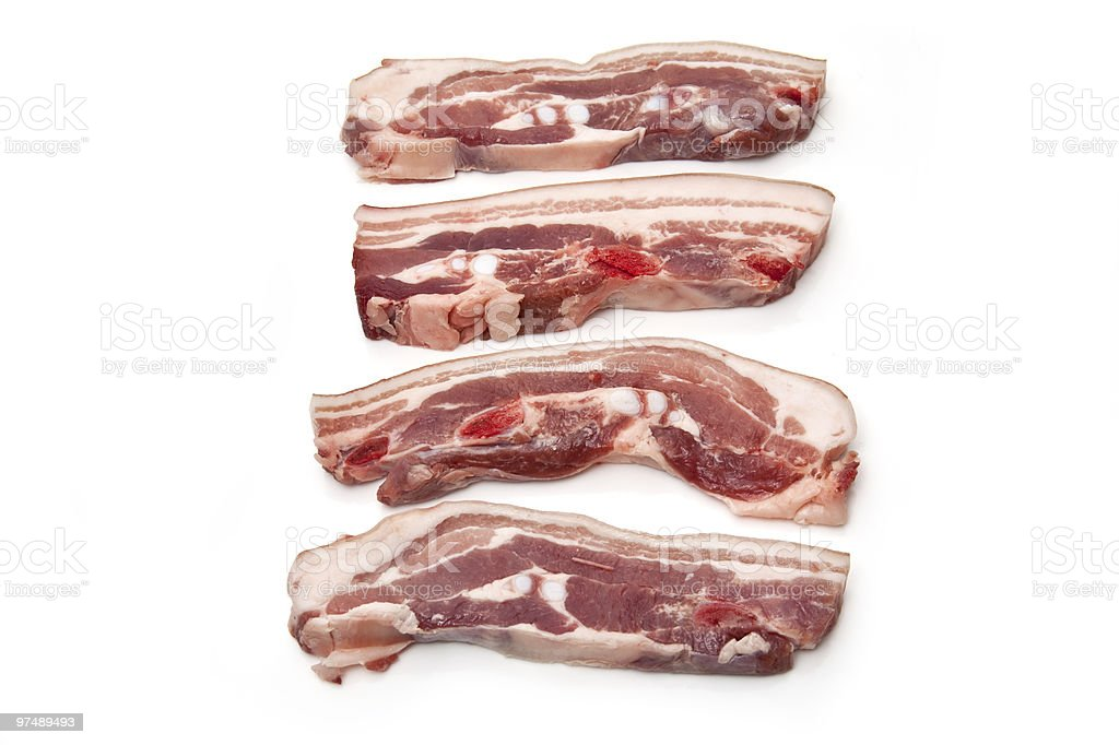 Belly pork slices on a white background. royalty-free stock photo