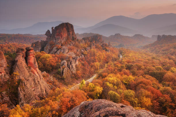 Belogradchik rocks. Magnificent panoramic sunset view of the Belogradchik rocks in Bulgaria. Autumn scene. stock photo