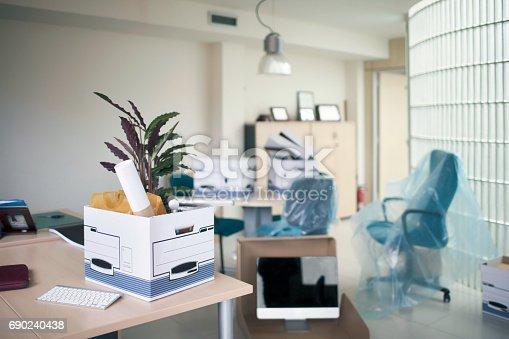 istock Belongings in box on desk in office 690240438