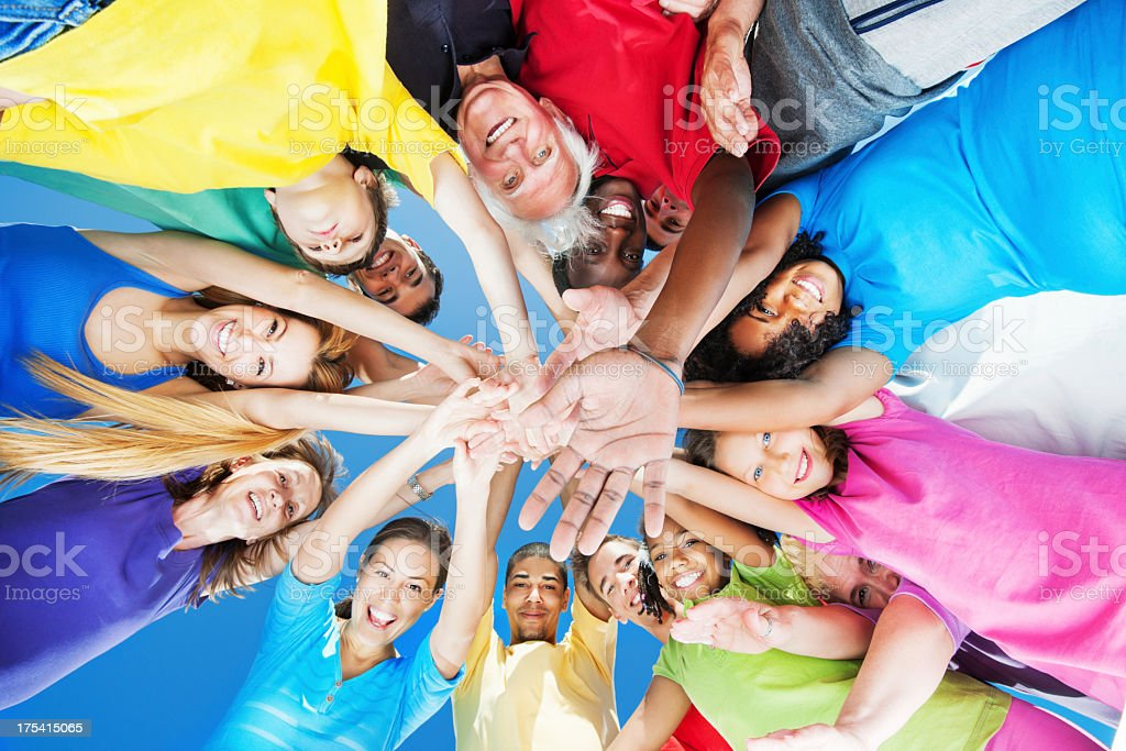 Below view, circle of arms with hands in center royalty-free stock photo