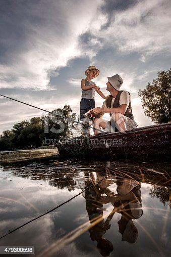 992209122 istock photo Below view of a father and son communicating during fishing. 479300598