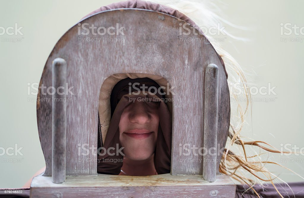 Below view of a woman on a massage bed. stock photo