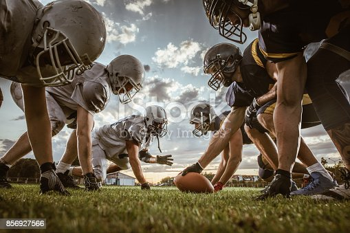 Low angle view of American football players confronting before the beginning of a match.
