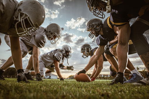 istock Below view of American football players on a beginning of the match. 856927566