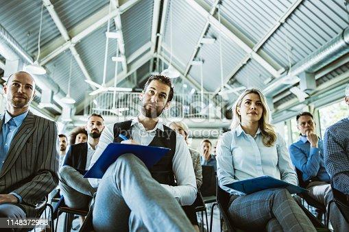 istock Below view of entrepreneurs attending a business seminar in board room. 1148372988