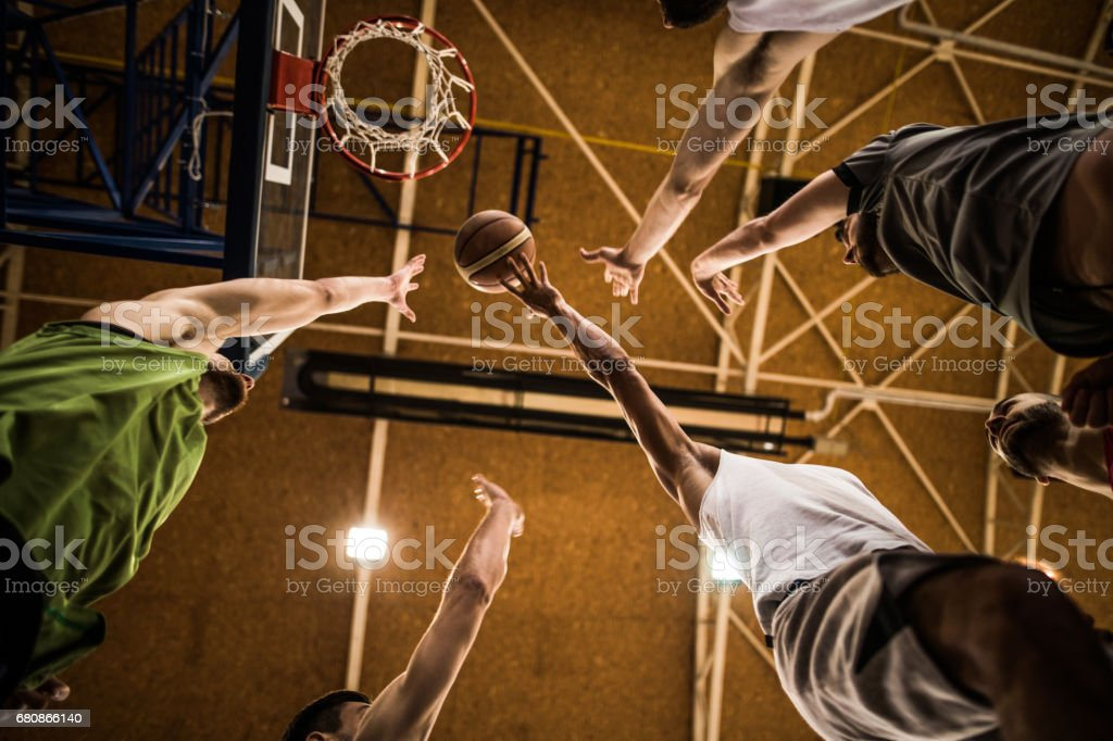 Below view of group of basketball players during a match. royalty-free stock photo