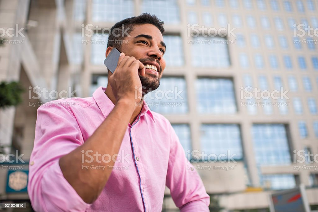 Below view of happy African American businessman on the phone. Lizenzfreies stock-foto
