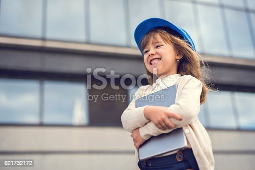 643843490istockphoto Below view of happy little architect with digital tablet. 621732172