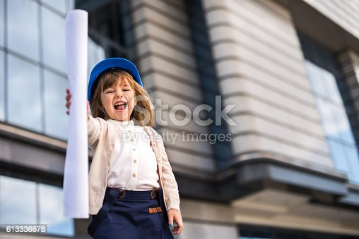 643843490istockphoto Below view of small architect with blueprints shouting outdoors. 613336678
